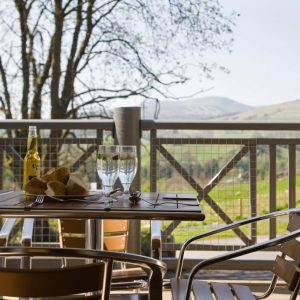 Dining al fresco at dog friendly cottages at Crieff Hydro, Perthshire, Scotland.