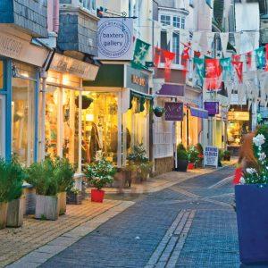 A market street bedecked with bunting in Devon
