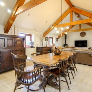 A large dining table with chairs in a luxury kitchen in a dog friendly cottage in Cornwall