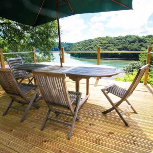 Dog friendly holiday cottage in Cornwall with decking overlooking river bed.