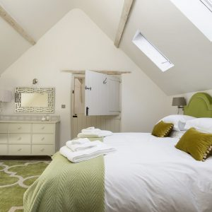 Enjoy a blissful night's sleep in the fresh, green, bedroom in a dog friendly accommodation, Cotswolds. Happy holidays.