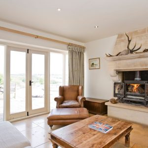 A roaring log fire in a dog friendly accommodation, Cotswolds.