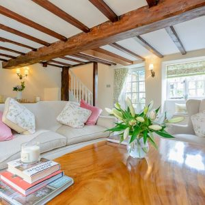 A beautiful light and airy beamed cottage interior available from Mulberry Dog Friendly Cottages, England.
