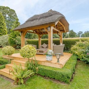 A pretty garden gazebo to be enjoyed as part of you self catering accommodation during your stay in a Mulberry Holiday Cottage.