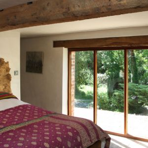 The characterful bedroom in the luxury dog friendly cottages Dorset, Lakeside Cottage