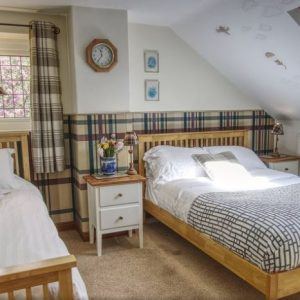 A beautifully decorated twin bedroom at Barnacre dog friendly cottages, Preston, Lancashire