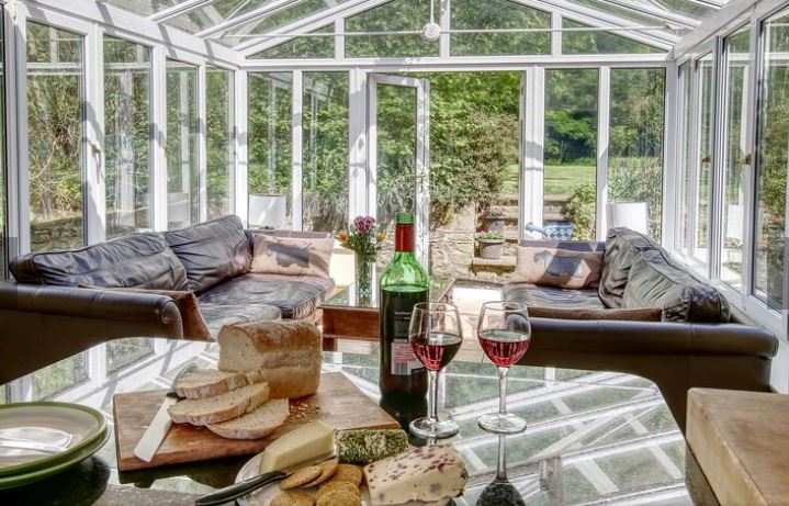 The beautiful conservatory all set for cheese and wine at Barnacre Dog Friendly Cottages in Preston, Lancashire