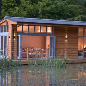 A beautiful riverside lodge with decking available from New Forest Dog Friendly Cottages
