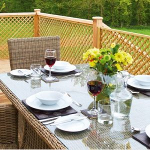 Dining al fresco on this beautiful raised decking with rattan table and chairs all set for lunch at Wakes Hall Dog Friendly Cottages Essex