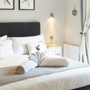 A clean, stylish and contemporary bedroom at Wakes Hall Self Catering holiday cottages, Essex.