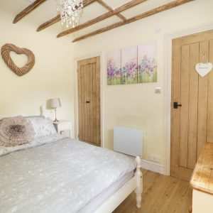 Sweet dreams, a cosy bedroom in Dream Homes, holiday cottages, Dorset.