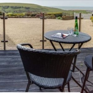 A beautiful coastal view to be enjoyed from the terrace of Dream Cottages dog friendly cottages in Dorset.
