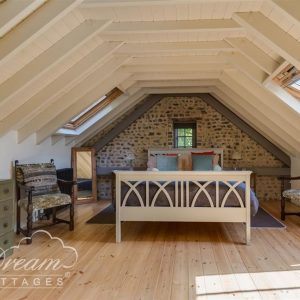 A loft bedroom, perfect for relaxation whilst on holiday in Dorset.