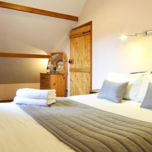 Comfortable bedroom at Flowery Dell dog friendly cottages North Yorkshire