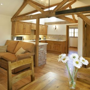 A clean and contemporary living and dining area with stripped wooden floors providing the perfect dog friendly cottage in Bicester Oxfordshire.