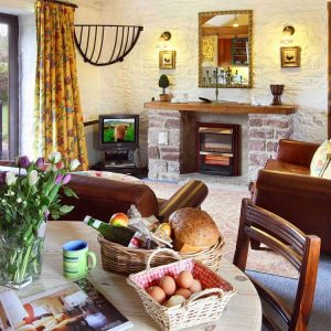 A cosy cottage with living and dining area at Oatfield Holiday Cottages, Forest of Dean