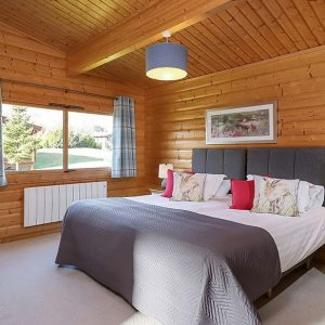 A beautiful wood panel bedroom at South Winchester Lodges, dog friendly accommodation in Hampshire