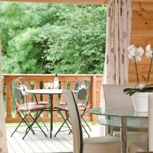 Dining area with French doors leading to an outside all set for a chilled glass of wine for two at South Winchester Lodges, Hampshire.