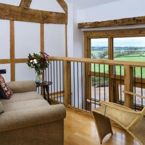 A mezzanine with comfy sofa and beautiful views across Herefordshire countryside.