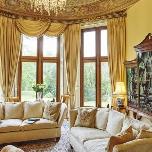 The stunning lounge with floor to ceiling elegant windows at the Pale Hall Hotel, North Wales