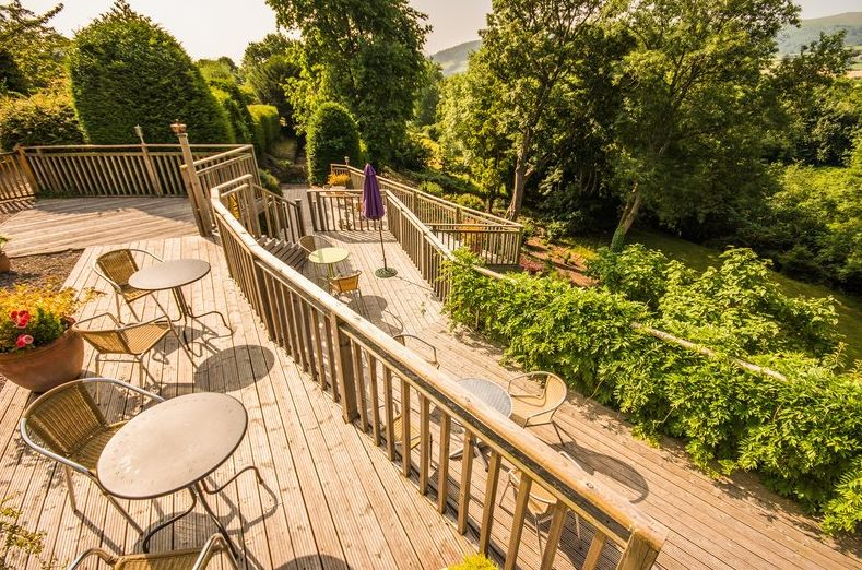 Sweeping decked terraces overlooking the gardens at Peterstone Court Hotel in Wales, perfect for a dog friendly holiday.