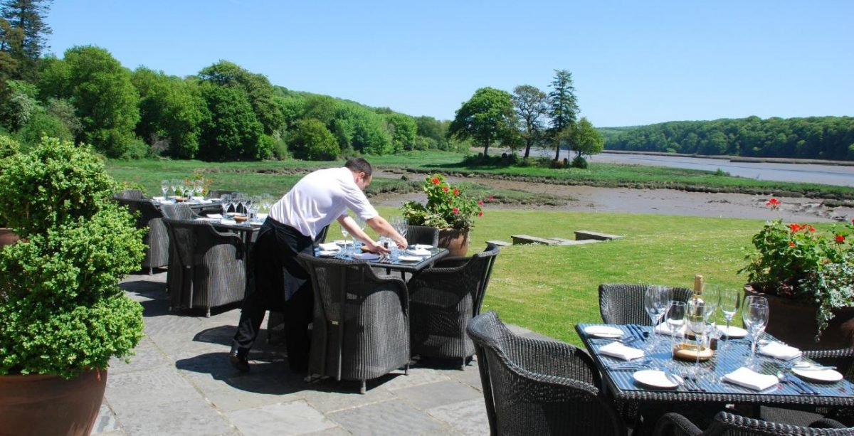 Getting ready for an alfresco lunch on the terrace with sweeping countryside views at the Slebech Park Estate, Wales.