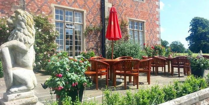 Your dog can join you for an alfresco lunch on the terrace at Willington Hall, a dog friendly hotel in North West England