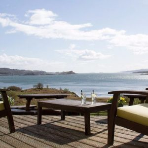 Enjoy oustanding sea views from the terrace at Loch Melfort dog friendly hotel Scotland