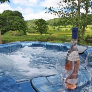Bubbling hot tub with beautiful views across the Welsh countryside available from River Catcher pet friendly Cottages, Wales