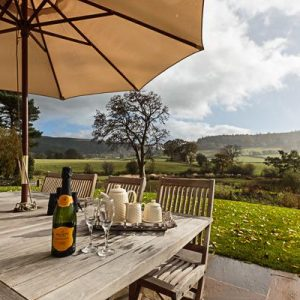 Alfresco dining with Rivercatcher Pet friendly cottages Wales