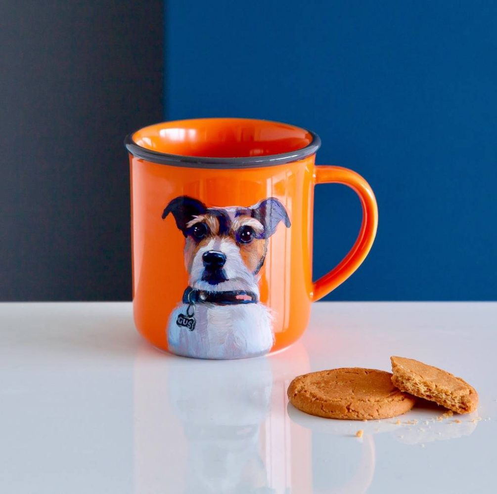 A bright and cheerful orange personalised dog mug featuring a very cute jack russell terrier