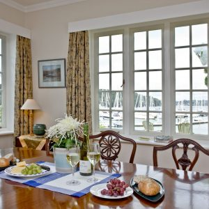 The beautiful dining room with harvour views at Cregoes, luxury coastal cottage in the South West.